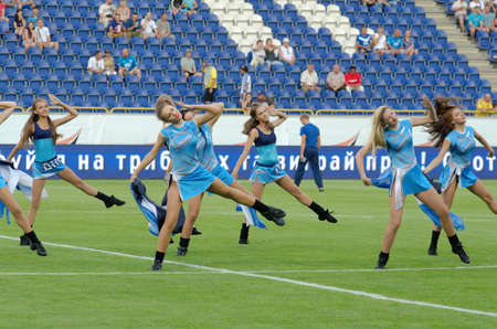 DNIPROPETROVSK, UKRAINE - AUGUST 9, 2015: Members of the Dance Team Dnipro perform during  the Premier League football match FC Dnipro against FC Dynamo.