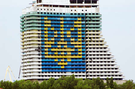 The largest image of the arms of Ukraine, which became part of Guinness Book of Records, performed on the facade of the unfinished hotel Sail, August 17, 2014 in Dnipropetrovsk, Ukraine
