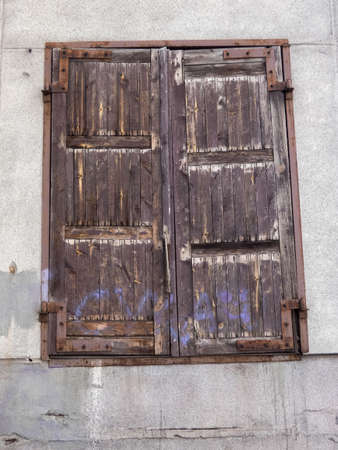 Textured doors of an old warehouse. Old wooden gate with metal inserts. Stok Fotoğraf