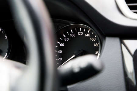 modern speedometer on a black dashboard