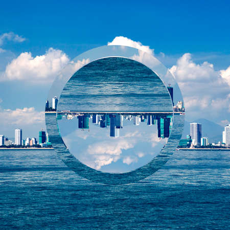 cityscape with a view of the sea shore with skyscrapers. Trendy minimalist Polyscape effect with transparent figure - circle  Banco de Imagens