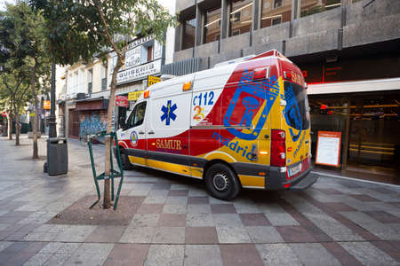 Bright ambulance in the street of Madrid, Spain 2018-08-05 Editorial