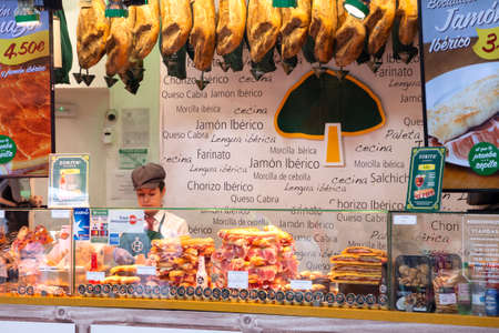 Selling of traditional Spanish jamon (spanish ham) and other snacks and delicatessen in street shop on the street of Madrid, Spain 2018-08-18