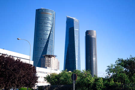 Four modern skyscrapers (Cuatro Torres) in business financial district of Madrid, Spain 2018-08-14 Stock Photo - 124658915