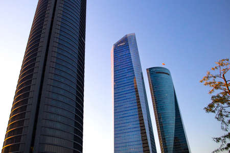 Four modern skyscrapers (Cuatro Torres) in business financial district of Madrid, Spain 2018-08-14 Stock Photo - 124658920