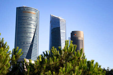 Four modern skyscrapers (Cuatro Torres) in business financial district of Madrid, Spain 2018-08-14 Stock Photo - 124658931
