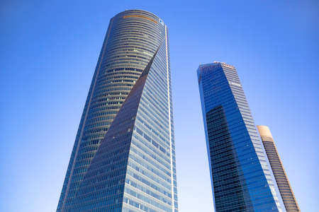 Four modern skyscrapers (Cuatro Torres) in business financial district of Madrid, Spain 2018-08-14