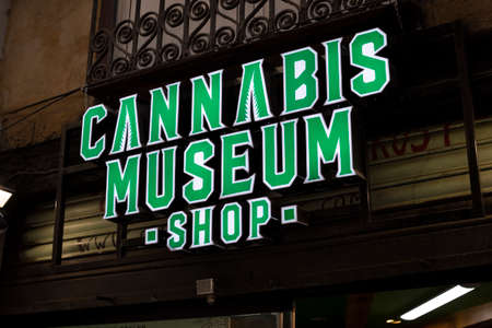 Legalized marijuana. Green signboard cannabis museum shop on the street of Barcelona, Catalonia, Spain, 30 April, 2019