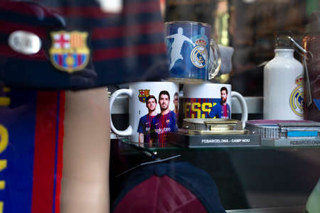 Futbol Club Barcelona official souvenirs: cup, bottle, thermos, clothing and other on the showcase in the shop in Barcelona, Catalonia, Spain. 2019-05-01.