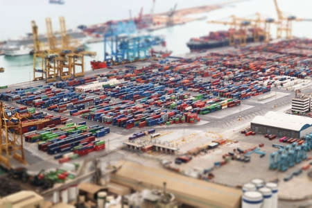 Aerial view on the sea port and containers with modern tilt-shift photo effect. Barcelona, Catalonia, Spain 2019-04-28 Editorial