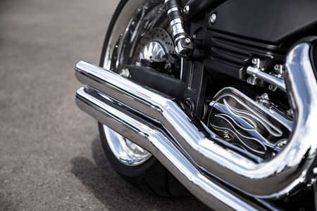 Motorcycle exhaust pipe. Chrome shiny clean motorbike tail-pipe. Close up view. Stock Photo - 127037360