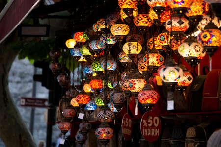 Shop with traditional mosaic multi colored turkish lamps or lanterns. Popular souvenir from Turkey. Istanbul, Turkey, 2019-08-10 Editorial