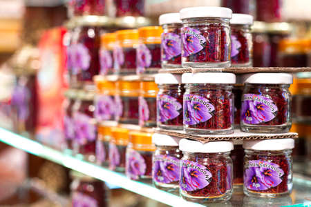 Small jars with red saffron on the shelf in the shop. Popular souvenir from Istanbul, Turkey 2019-08-13
