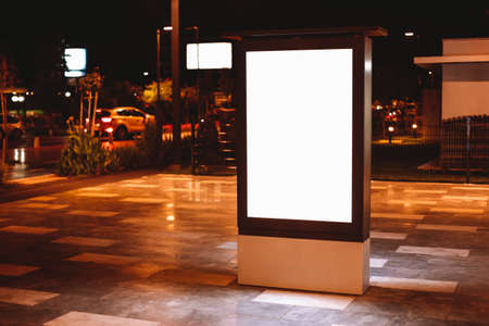 Street advertising mock up template with copy space. Outdoor commercial banner with white empty display on the night street Zdjęcie Seryjne