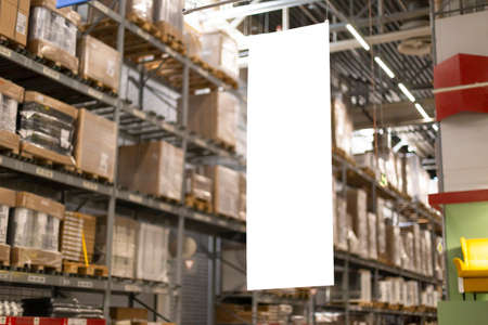 Blank mock-up advertising with copy space in the warehouse storage with rows of shelves with goods boxes.