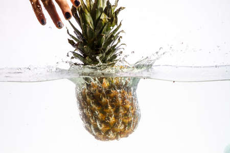 Fresh pineapple jumping into water 스톡 콘텐츠