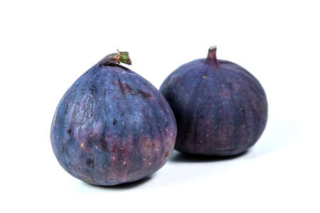 figs on white background. two things. fig, fruit, white, food, exotic, fresh, slice, purple, Фото со стока