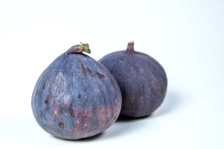 figs on white background. two things Фото со стока