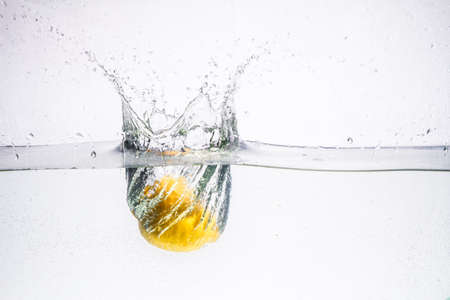 three peppers falling in water. water, drop, bubble, food,