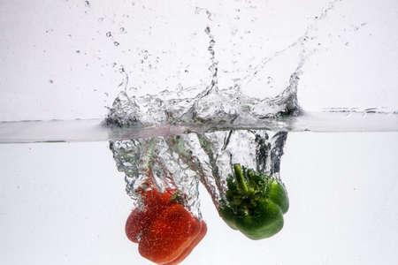 Fresh pineapple jumping into water Фото со стока