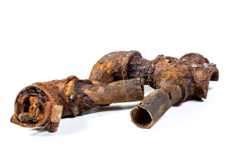 Fragments of old cast-iron water pipes on white background. After many years of operation corroded metal pipe was destroyed. Rusty steel tube with holes of metallic corrosion. Rusty cast iron, metal Stock fotó