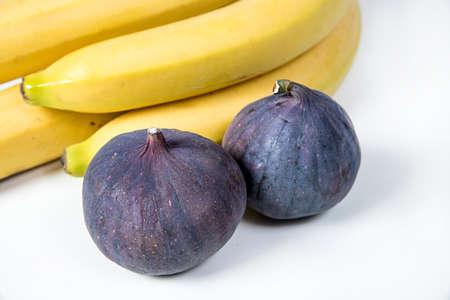 figs and bananas, beautiful fruits, bananas, purple figs, close-up, vitamins concept, vegan food, healthy eating,