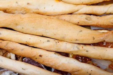 Close up of fresh baked Italian grissini breadsticks covered with cloth
