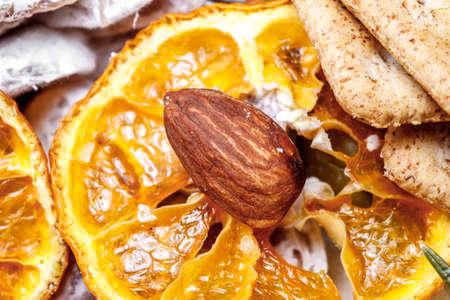 still life closeup nuts and dried orange Фото со стока