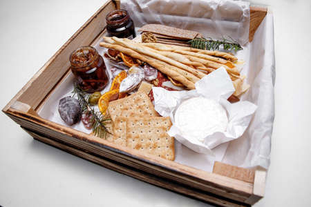 Catering. Snacks and goodies. Scrap delivery set. Jam, biscuits, sausage, cheese, orange and more