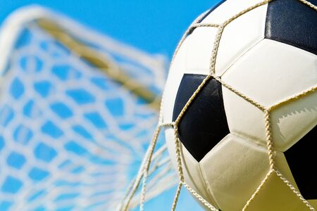 Soccer ball in net Stock Photo - 13275053