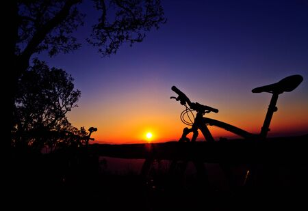 Bike silhouettes on mountain photo