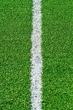 White stripe on the green grass field