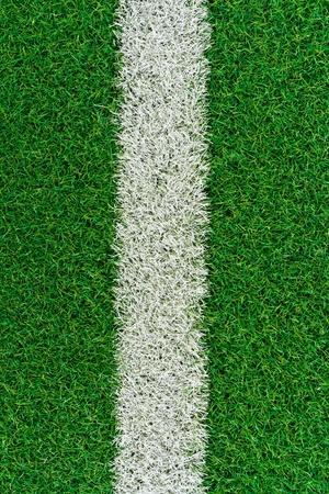 White stripe on the green grass field photo