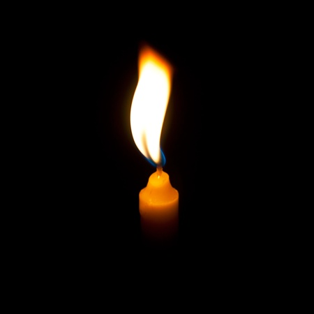 Yellow candle in dark background Stock Photo - 14155203