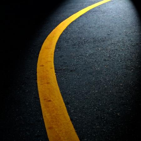 Yellow lines on asphalt road Stock Photo