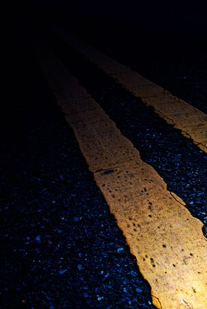 Road Marking - Double Yellow Lines on asphalt Stock Photo