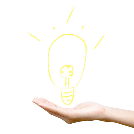 Yellow light bulb on hand Stock Photo