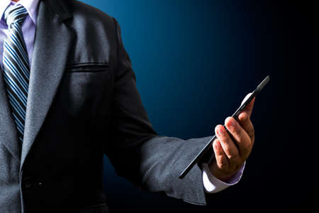 Businessman using a tablet computer Stock Photo - 18811099