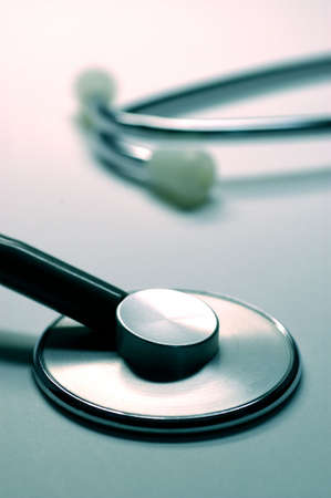 thump: close-up of stethoscope isolated on blue background