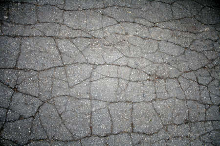 cracked asphalt pavement