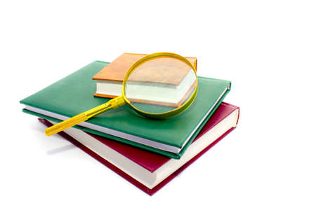 This is magnifier lens and pile of books Stock Photo