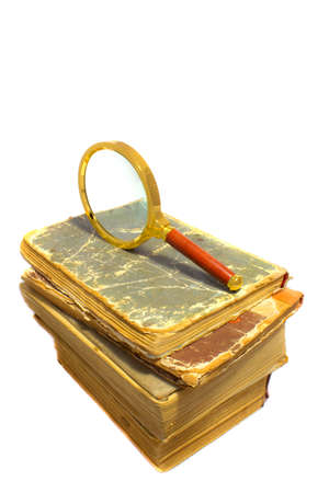 old books and magnifier Stock Photo