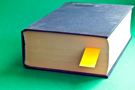 This is black book with big yellow bookmark