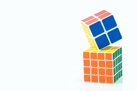 Bangkok, Thailand - November 11, 2017: Rubiks cube two type is good for brain on a white background. Rubiks Cube invented by a Hungarian architect Erno Rubik in 1974. Editorial