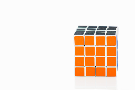 Bangkok, Thailand - November 11, 2017: Rubiks cube 44 is difficult for play but good for brain on a white background. Rubiks Cube invented by a Hungarian architect Erno Rubik in 1974.