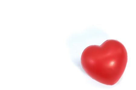 Corazón rojo aislado en blanco. Concepto de San Valentín Foto de archivo