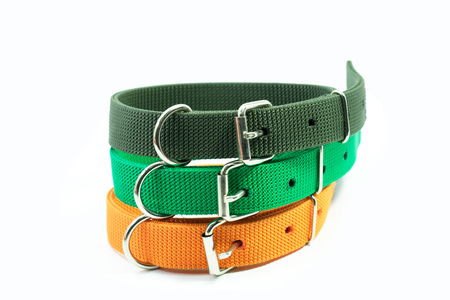 Pet supplies about collars stack for pet on white background.