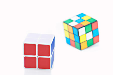 Bangkok Thailand - November 11 2017: Rubik's cube two type is good for brain on a white background. Rubik's Cube invented by a Hungarian architect Erno Rubik in 1974. Editorial