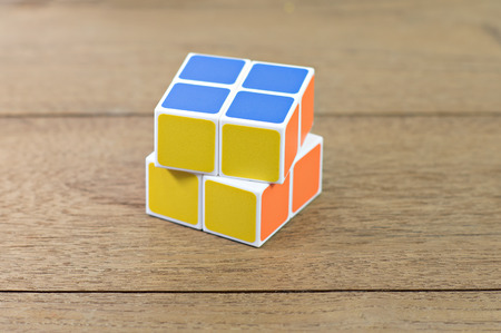 Bangkok- Thailand Rubiks cube on desk.   Rubiks Cube o cube toy puzzle, 2x2 square. Rubiks Cube invented by a Hungarian architect Erno Rubik