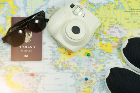 Accessories for Travel, Sunglasses, shoes, passport and camera Concept  plan of travel.